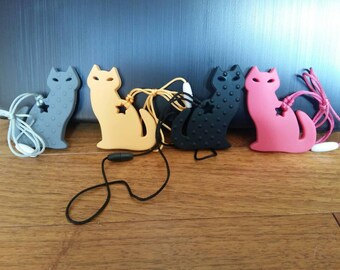 Silicone Cat Teether/Pendant with cord and clasp.