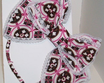Kawaii pink and brown modern Japanese lolita hair bow lace trimmed; left side.