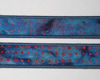 Red spot bookmark on blue batik