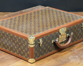 Louis Vuitton suitcase with key