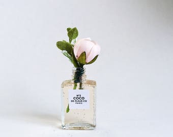 """5"""" Small blush bud in champagne colored permanent water in chanel inspired vase"""