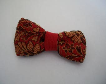 Bow is a handmade red with embroidered flowers