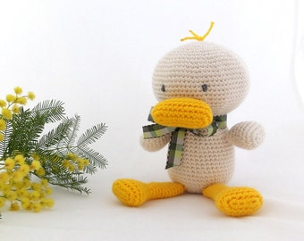 Duck handmade amigurumi toy, crocheted stuffed animal.