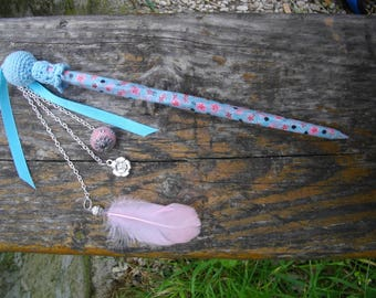Light blue hair chopstick with pink flowers pattern embellished with ribbons,, a pink Indian pearl, a pink feather