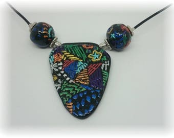 Designs on composition necklace - polymer and beads on black leather cord