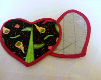 Heart shaped potholders with peppers