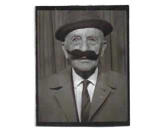 """Vintage Snapshot """"In Disguise"""" Elderly Gentleman Wears Fake Handlebar Mustache Photobooth Black & White Found Vernacular Photo"""