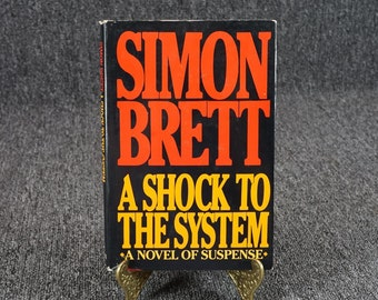 A Shock To The System By Simon Brett Book Club Edition C. 1985