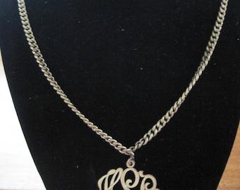 Gold vintage monogram necklace.
