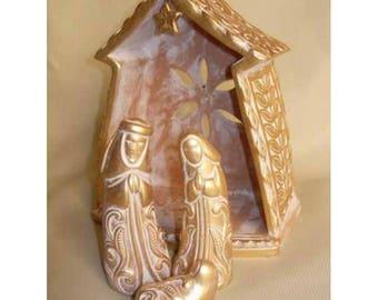 Conceptual gold Nativity scene