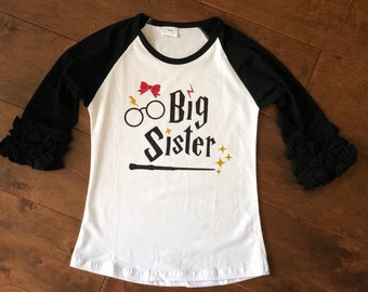 Wizard inspired big sister design on an icing ruffle raglan.