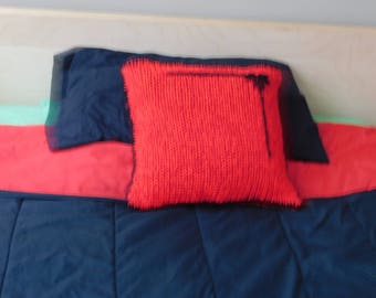 Red handmade of wool pillowcase on a small pillow