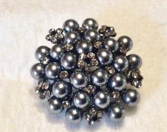Gray pearls clear black rhinestones domed brooch pin.