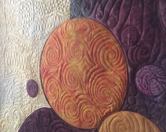 Art quilt planets by Ellen Abshier of Laugh Sew Quilt