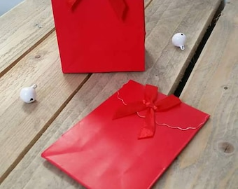 X 2 cardboard flap and velcro closure red gift box