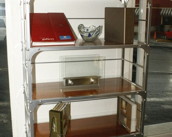 Stotage shelving unit fabricated in square steel and peruvian red cedar wood