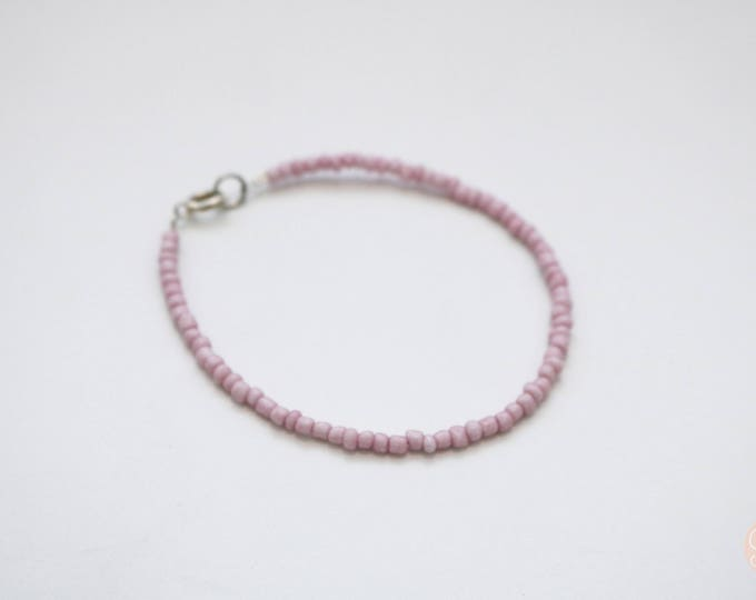 Purple seed bead bracelet.