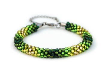 Beaded kumihimo bracelet - green-gold ombre with lobster clasp and extender chain - chevron design