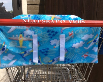 Shopping cart seat cover, Flying High. 2 available, check different back pockets