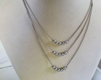Vintage Monet silver tone multi strand necklace.