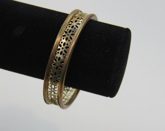 Vintage punched brass metal bangle with floral cutouts bracelet 80's gold tone