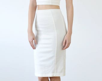 Stretchy Elegant Women's Bodycon White Pencil Skirt with a High Waist. Smart Body Contour Knee Length Fitted Skirt with Kick Pleat