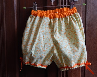 Baby bloomers made green floral and orange elastic waist