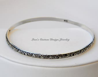 Scroll leaf patterned sterling silver bangle bracelet