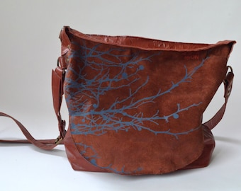 Big brown leather tote with blue print