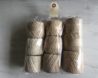 A Vintage Lot of 9 Beige Crochet Cotton Spools