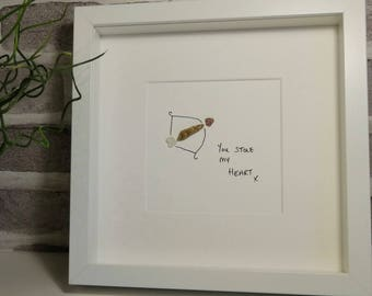 Cupid's bow pebble art picture - great for Valentines Day