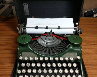 1931 green Underwood Universal portable 4-bank typewriter with case