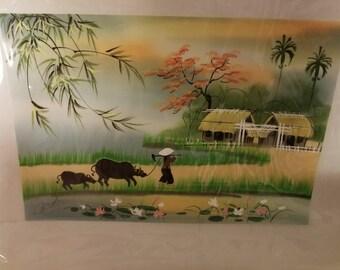 Asian farmer painting on silk