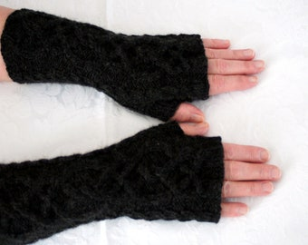 Smart and stylish hand knitted cabled fingerless gloves by Liz