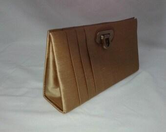 Exclusive handmade raw silk clutch bag.