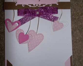 Its a girl with dangling hearts