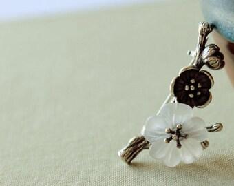 Silver blossom brooches