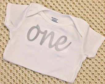 """Silver Iron-On vinyl cursive """"one"""" lettering for yearly, monthly or birthday onesie- Lettering ONLY (First Class Mail Shipping)"""