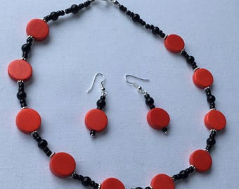 red and.black beaded choker style necklace and earrings