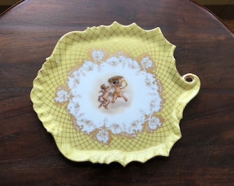 Carl Knoll Carlsbad Cherub Yellow/Gold Plate