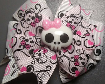 Skull bow with pink and black swirls