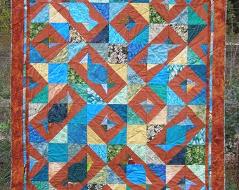 Lap quilt, rust asymetrical squares & rectangles on blues and greens