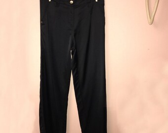 Satin pants with gold detail. 28