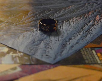small wooden painted ring (simple flower detail)