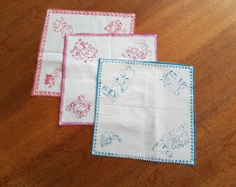 3 multicolored handkerchiefs with the drawings of the characters of cartoons printed cotton