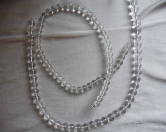 2 Strands of Glass Beads, Shades of Crystal. Sold per 16 inch strands. The strands are 8mm and 10mm round beads.