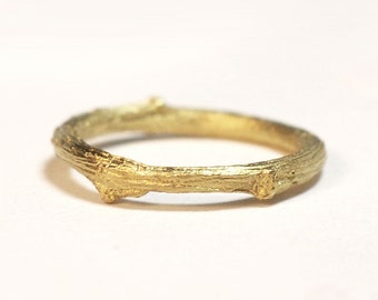 slim 18kt gold twig ring.