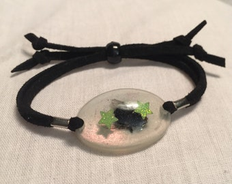 Real Fly Suede Adjustable Resin Pendant Bracelet.  Real Insect Preserved with Glitter Stars.