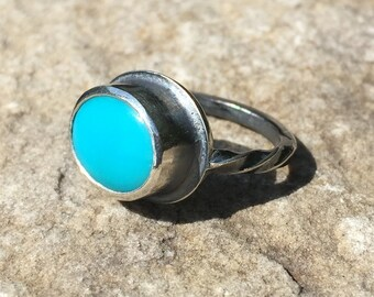 Oxydized sterling silver ring with bezel set oval afghani turquoise cabochon