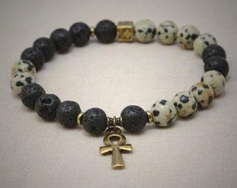 Lava rock and dalmatian jasper stretch bracelet - antique brass Ankh charm